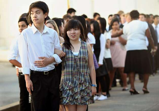 Ninth graders Scott Lau (left), 14 years old, and Qiling Chen (right), 15 years old, line up under the direction of Darlene Quinney (background) as they pair up for a night of ballroom dancing at the girls gym in Oakland, Calif., on Thursday,  May 5, 2011. Photo: Liz Hafalia, The Chronicle