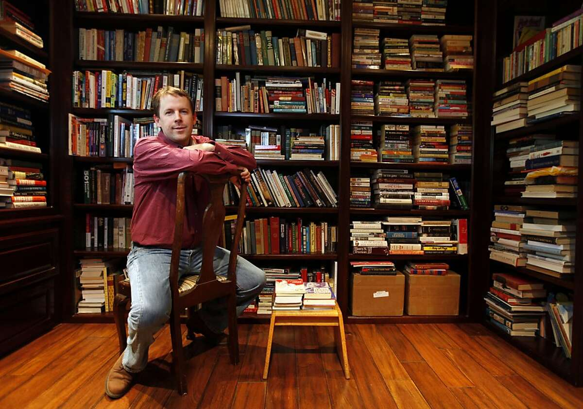 Mark Coker stands in his personal library on the Peninsula. Coker became frustrated when publishers wouldn't buy his novel, so he used his Silicon Valley startup background to create a tech company that would help other aspiring writers to turn their works into e-books. Today Smashwords is the leading site for people who want to self-publish anything from vampire novels to family histories, and has tens of thousands of e-books for sale on its own site and through other online retailers like Barnes & Noble. Wednesday May, 4, 2011
