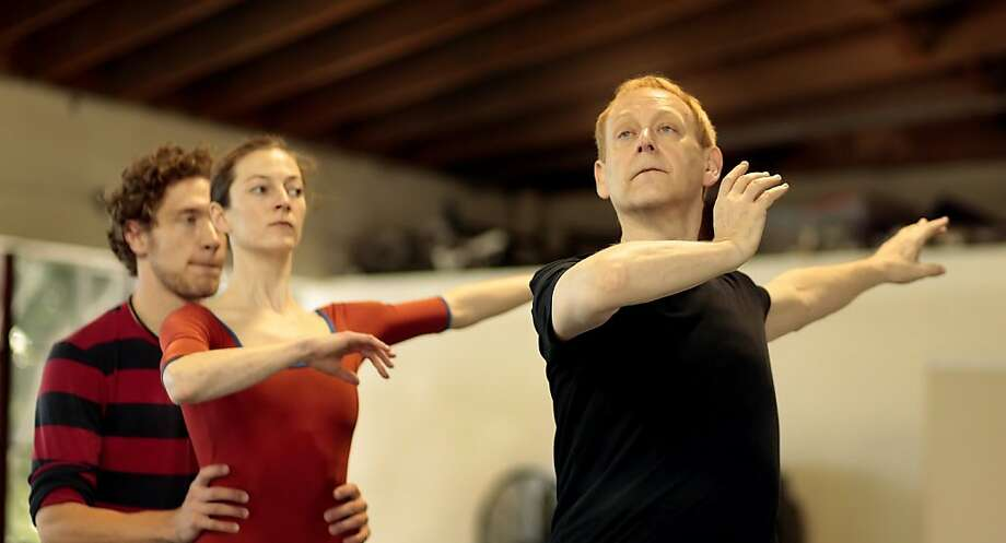 Artistic Director of Choo-San Goh & H. Robert Magee Foundation, Janek Schergen, right,  directs dancers Travis Walker and Jane Rohm as they rehearse for an upcoming performance, Thursday April 7, 2011, in San Francisco, Calif. Photo: Lacy Atkins, The Chronicle