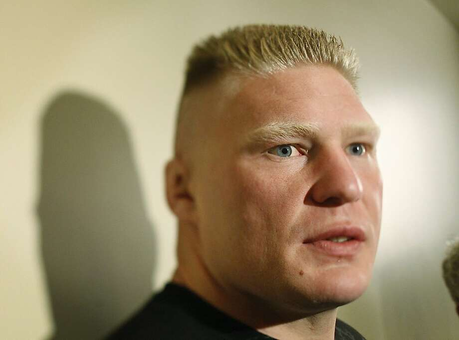 UFC heavyweight title holder Brock Lesnar speaks with the media at Mandalay Bay in Las Vegas, Wednesday, July 8, 2009. Lesnar will fight Frank Mir at UFC 100 Saturday in Las Vegas. (AP Photo/Las Vegas Review-Journal, John Locher) ** LAS VEGAS SUN OUT. MAGS OUT. NO SALES. ** Photo: John Locher, AP