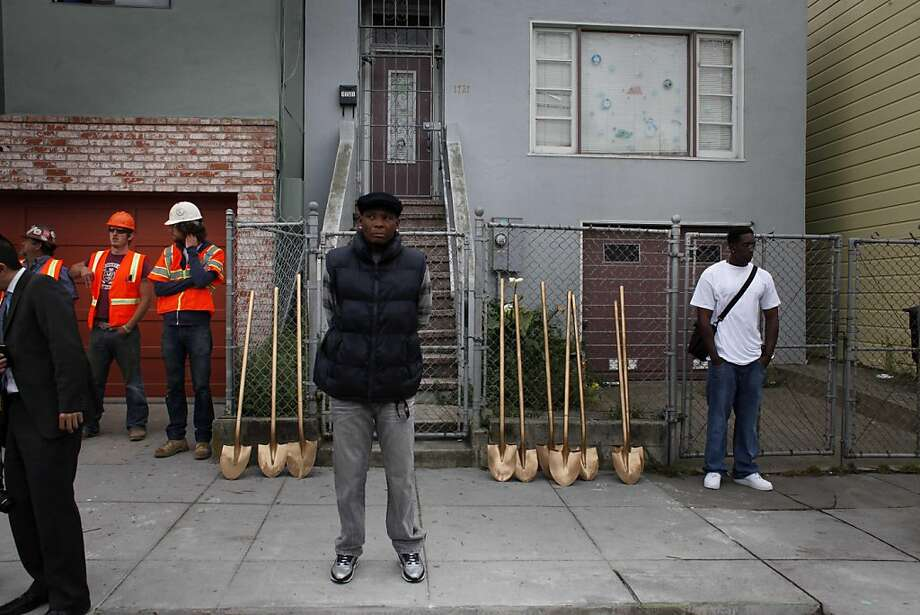 "Larry Ardorin (cntr), 53, watches closely as change is promised in his neighborhood during a ground breaking ceremony for the Newcomb Avenue Steetscape Model Block Improvement project on the 1700 block of Newcomb Avenue in the Bayview Hunter's Point District on Wednesday May 11, 2011 in San Francisco, Calif. The pilot project will replace significant areas of concrete with new landscaping, trees and planters. ""I'm unemployed. To be honest they're not doing enough for the community,"" said Ardorin. Photo: Mike Kepka, The Chronicle"