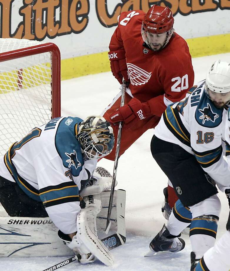 San Jose Sharks goalie Antti Niemi (31), of Finland, stops a shot by Detroit Red Wings left wing Drew Miller (20)  as Devin Setoguchi (16) watches in the first period of Game 6 of a second-round NHL Stanley Cup playoff hockey series in Detroit, Tuesday, May 10, 2011. Photo: Paul Sancya, AP