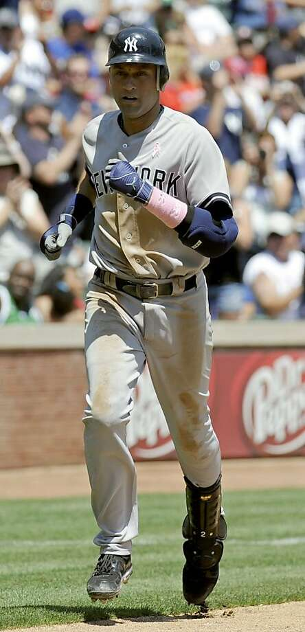 New York Yankees shortstop Derek Jeter (2) rounds third base after his fifth inning home run during a baseball game against the Texas Rangers, Sunday, May 8, 2011 in Arlington, Texas. Photo: Matt Strasen, AP
