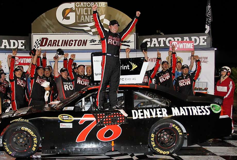 DARLINGTON, SC - MAY 07:  Regan Smith, driver of the #78 Furniture Row Companies Chevrolet, celebrates in Victory Lane after winning the NASCAR Sprint Cup Series SHOWTIME Southern 500 at Darlington Raceway on May 7, 2011 in Darlington, South Carolina.  (Photo by Geoff Burke/Getty Images for NASCAR) Photo: Geoff Burke, Getty Images For NASCAR