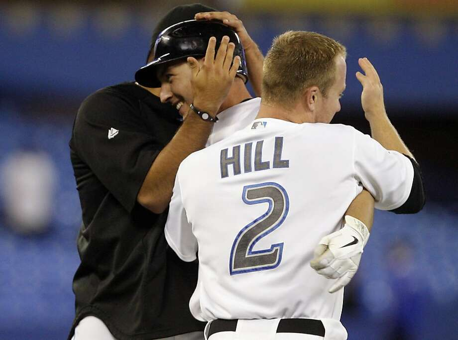 TORONTO, CANADA - MAY 10: Aaron Hill #2, Ricky Romero #24, congratulate David Cooper #20 of the Toronto Blue Jays after game winning RBI during MLB action against the Boston Red Sox at the Rogers Centre May 10, 2011 in Toronto, Ontario, Canada. Photo: Abelimages, Getty Images