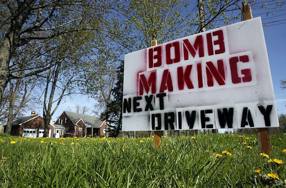 A sign is shown on the lawn of the home of Michael Heick, near the Jaffarya Center in Amherst, N.Y., Tuesday, May 10, 2011. Muslim leaders in the Buffalo, N.Y. suburb are upset over the sign insinuating that bombs are being made nearby at a newly opened mosque. Photo: David Duprey, AP