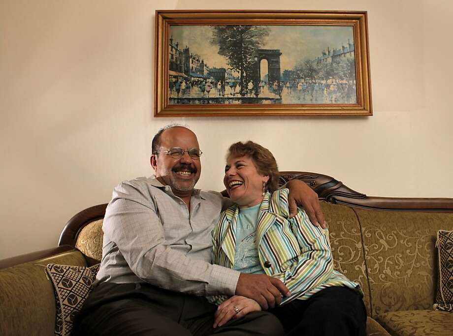 Nader, left, and Amira Aweti, who have been married for more than 30 years, sit on the couch at home. Photo: Lacy Atkins, The Chronicle