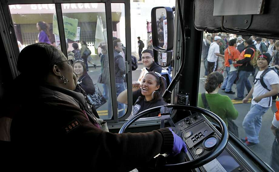 MUNI bus driver Vertrina Davis stops the bus and cheers as teh protestors march down Mission Street towards City Hall, fighting for education, Thursday March 4, 2010, in San Francisco, Calif. March 4 was declared a Day of Action to Defend Public Education,  throughout the state of California. Photo: Lacy Atkins, The Chronicle