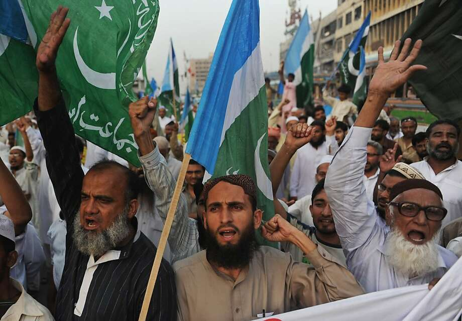 """Activists of Jamaat-e-Islami Pakistan shout slogans during an anti-American march in Karachi on May 6, 2011. Hundreds of Pakistanis took to the streets on May 6, cheering Osama bin Laden and shouting """"death to America"""" to condemn a unilateral US raid on their soil that killed the Al-Qaeda chief. Photo: Rizwan Tabassum, AFP/Getty Images"""