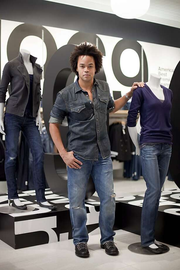 Gap executive vice president of design Patrick Robinson stands next to the company's revamped premium denim at the Gap store on Powell Street in San Francisco, Calif. on Tuesday, Aug. 4, 2009. Photo: Stephen Lam, The Chronicle 2009