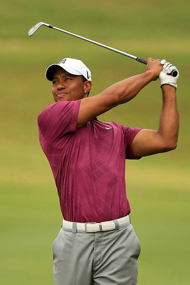 PONTE VEDRA BEACH, FL - MAY 11:  Tiger Woods hits a shot during a practice round prior to the start of THE PLAYERS Championship held at THE PLAYERS Stadium course at TPC Sawgrass on May 11, 2011 in Ponte Vedra Beach, Florida. Photo: Streeter Lecka, Getty Images