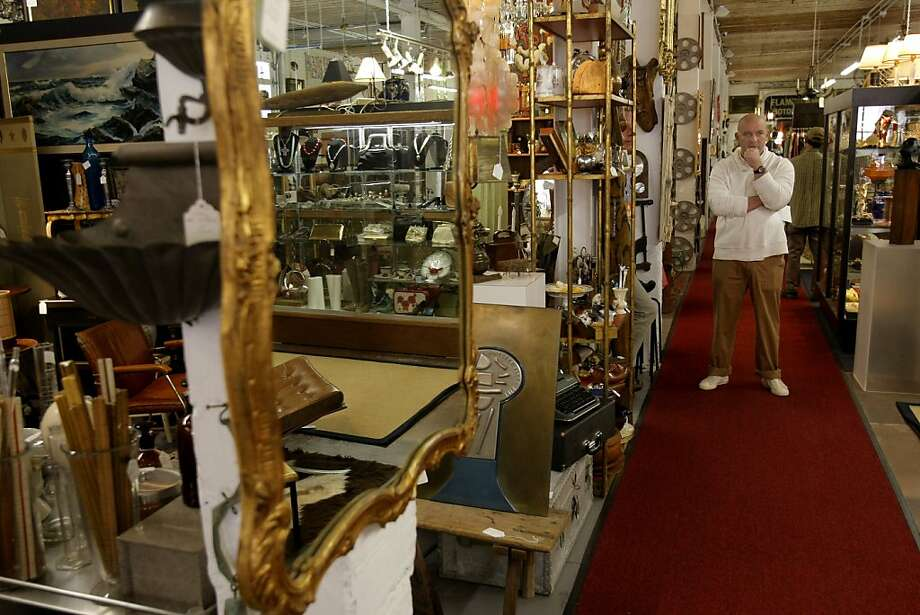 Brooks Griffin surveys the vast amount of items inside of Stuff, an antiques and vintage collective, in San Francisco, Calif., on Saturday, April 9, 2011. Photo: Thomas Levinson, The Chronicle