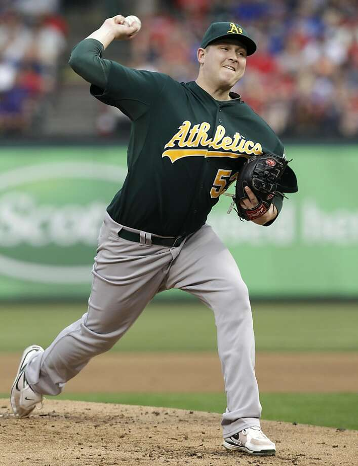 Oakland Athletics starting pitcher Trevor Cahill delivers to the Texas Rangers in the second inning of a baseball game Monday, May 9, 2011, in Arlington, Texas. Cahill pitched seven strong innings to earn his sixth straight win as the A's defeated the Rangers 7-2. Photo: Tony Gutierrez, AP