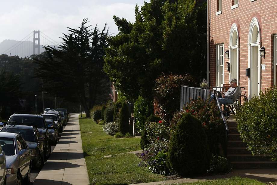 Mike Sexton reads outside his home on Liggett Avenue near Lover's Lane in the Presidio in San Francisco, Calif., on Friday, May 6, 2011. Photo: Thomas Levinson, The Chronicle