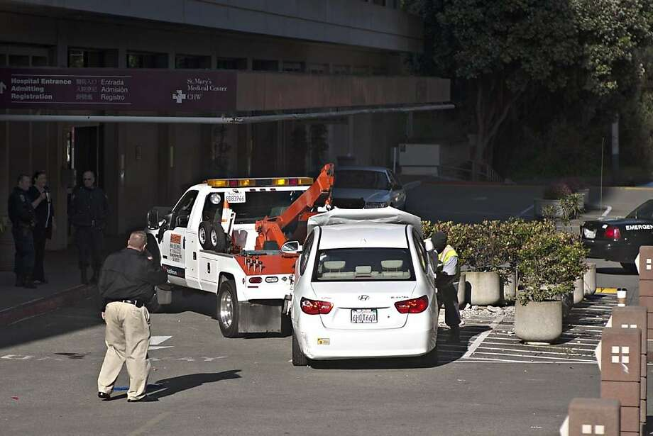 The 2009 Hyundai involved in a series of hit-and-run crashes in San Francisco on May 6, as it is towed away from St. Mary's Medical Center. Photo: Jim Herd