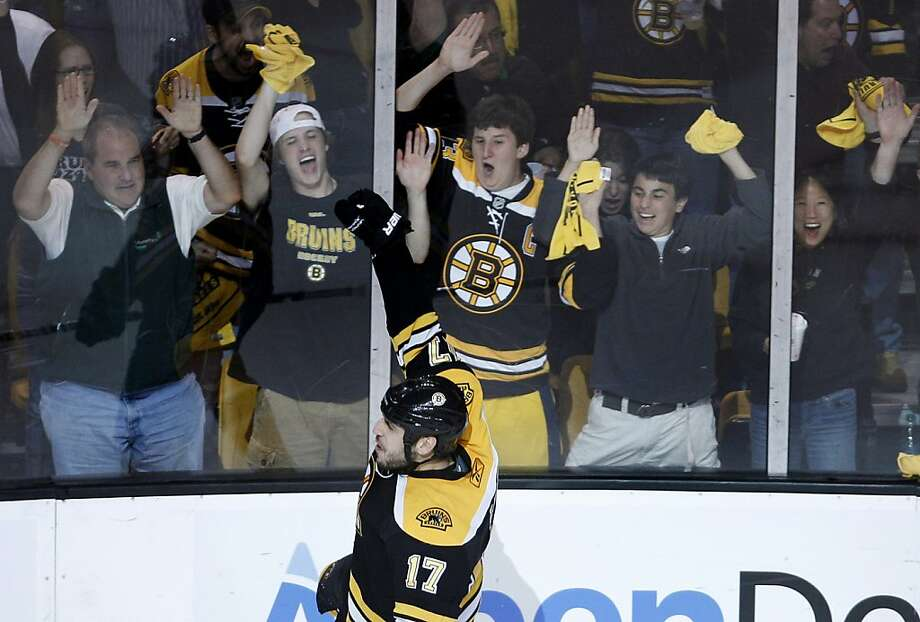 Boston Bruins fans celebrate the second goal of the night by left wing Milan Lucic against the Philadelphia Flyers during the third period in Game 4 of the Eastern Conference semifinal NHL Stanley Cup hockey playoffs series in Boston, Friday, May 6, 2011. Photo: Charles Krupa, AP