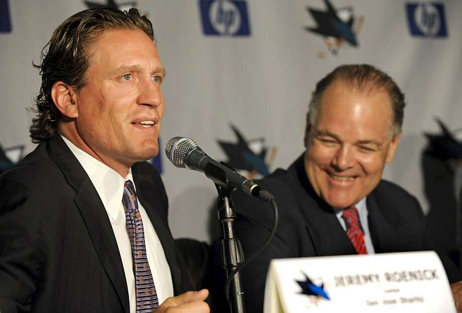 Jeremy Roenick, left, thanks his agent, Neil Abbott, during a news conference to announce his retirement from the NHL in San Jose, Calif., on Thursday, Aug.  6, 2009. Roenick leaves the game as one of four American's who scored 500 or more goals. He scored 513 overall. (AP Photo/Russel A. Daniels) Photo: Russel A. Daniels, AP