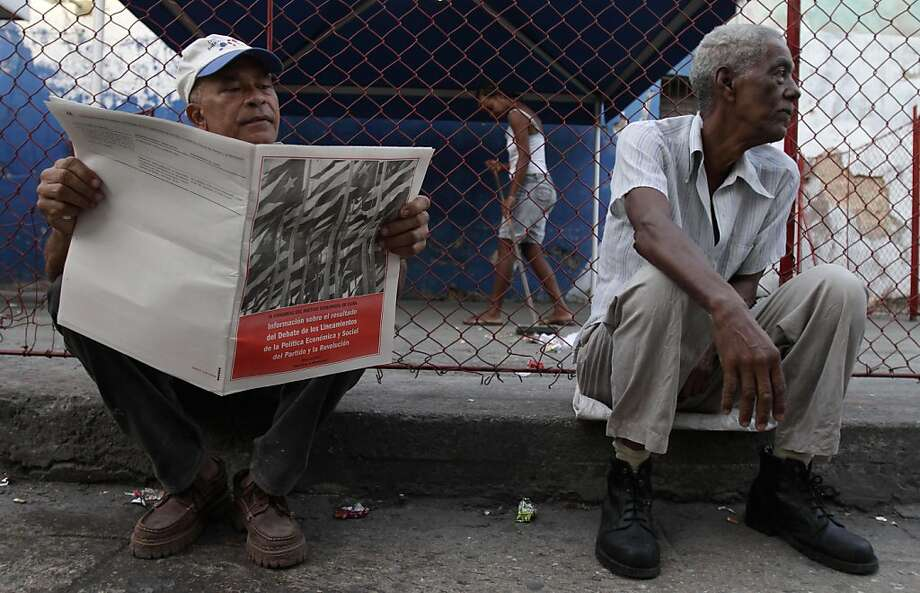 An unidentified man reads a copy of the document explaining the guidelines and economic changes that were approved at last month's Communist Party Congress, in Havana, Cuba, Monday May 9, 2011. Billed by President Raul Castro as a way to fix Cuba's economy, some of the changes include reforms that would make it easier for people to buy and sell private property, run small businesses and get credit to finance those operations. Photo: Franklin Reyes, AP