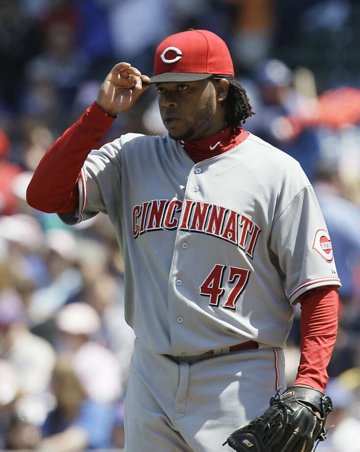Cincinnati Reds starter Johnny Cueto adjusts his cap during the first inning of a baseball game against the Chicago Cubs on Sunday, May 8, 2011, in Chicago. The Reds won 2-0 in Cueto's season debut. Photo: Nam Y. Huh, AP