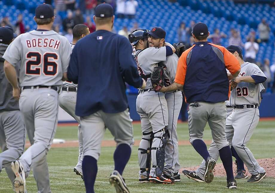 Teammates rush out as Detroit Tigers pitcher Justin Verlander, center right, and catcher Alex Avila celebrate Verlander's no-hitter against the Toronto Blue Jays in a baseball game in Toronto on Saturday, May 7, 2011. Photo: Darren Calabrese, AP