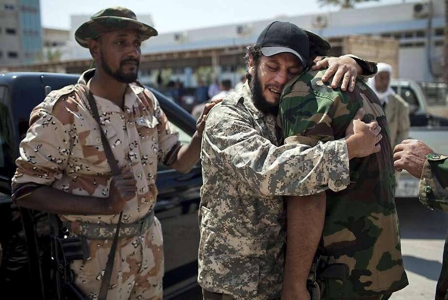 Comrades mourn the death of Hussein Saad Al Awami, a rebel fighter who was killed Monday during fighting against Moammar Gadhafi troops, during his funeral in Benghazi, Libya, Tuesday, May 10, 2011.  (AP Photo/Rodrigo Abd) Photo: Rodrigo Abd, AP