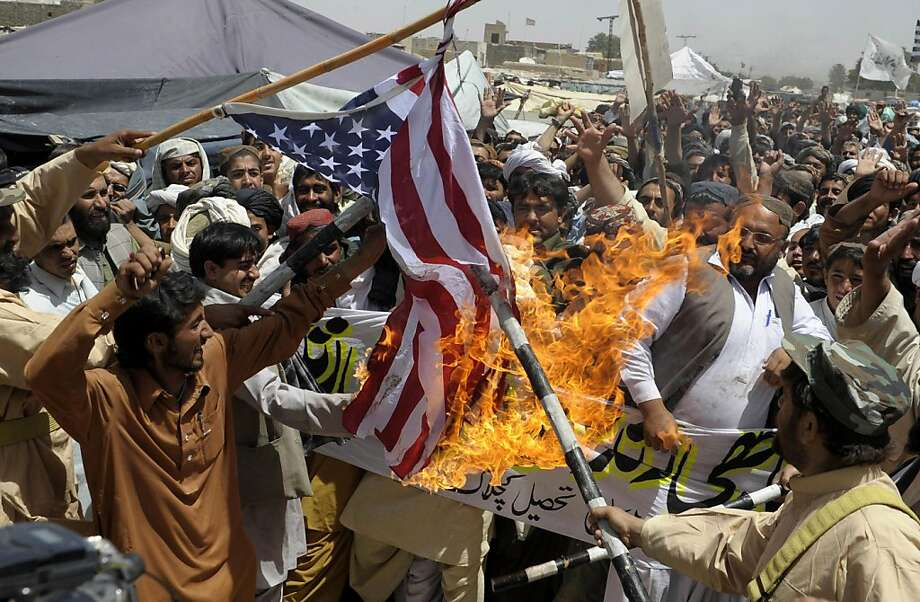 "Pakistani Islamists burn a US flag against the killing of Osama bin Laden during a protest outskirt of Quetta on May 6, 2011. Al-Qaeda confirmed the death of its leader Osama bin Laden but warned that those rejoicing his killing would have their ""blood mixed with tears,"" while vowing the jihadist network would live on. Photo: Banaras Khan, AFP/Getty Images"