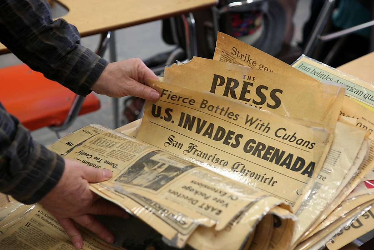 American Democracy teacher Chuck Raznikov flips through a stack of laminated front pages which he uses to instruct an American Democracy class at Lowell High School in San Francisco, Calif., Wednesday, May 4, 2011.