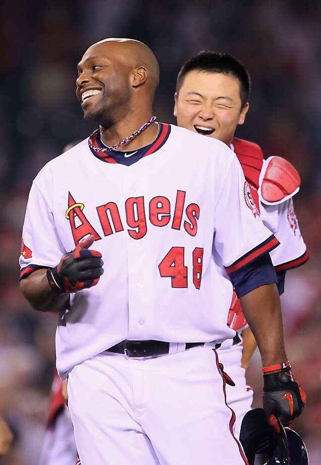 ANAHEIM, CA - MAY 06:  Torii Hunter #48 of the Los Angeles Angels of Anaheim is congratulated by Hank Conger #16 after hitting the game wining RBI single against the Cleveland Indians in the 11th inning at Angel Stadium of Anaheim on May 6, 2011 in Anaheim, California. Photo: Jeff Gross, Getty Images