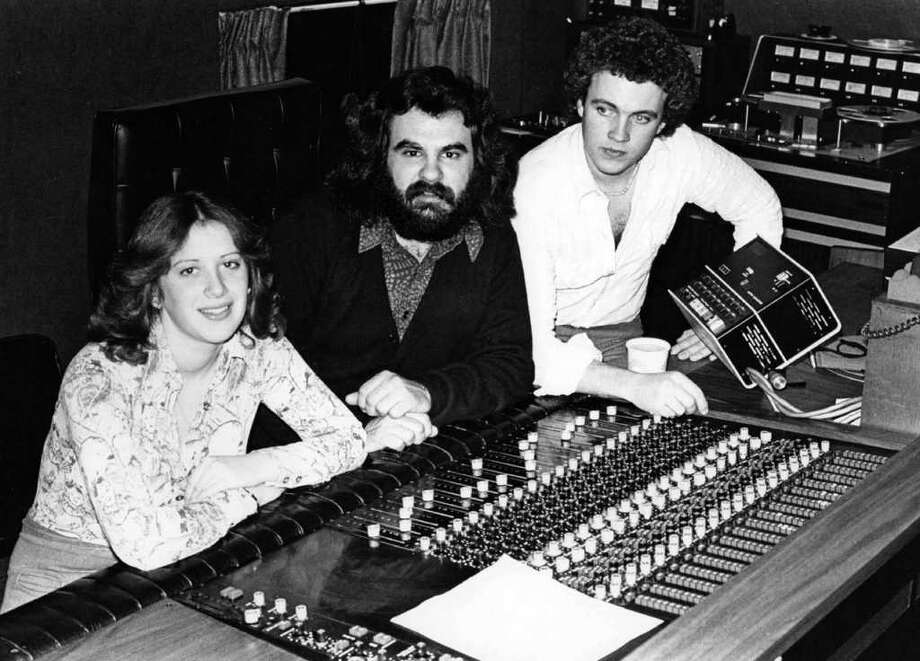 Music producer Paul Leka, center, with Steve Gaspár and Suzanne Nelson, who is now Gaspárís wife. In the late 1960s and through the 1970s, Lekaís Connecticut Recording Studios on Main Street in Bridgeport was where a number of top artists recorded. The photo was taken at the studio in about 1972. Photo: Contributed Photo