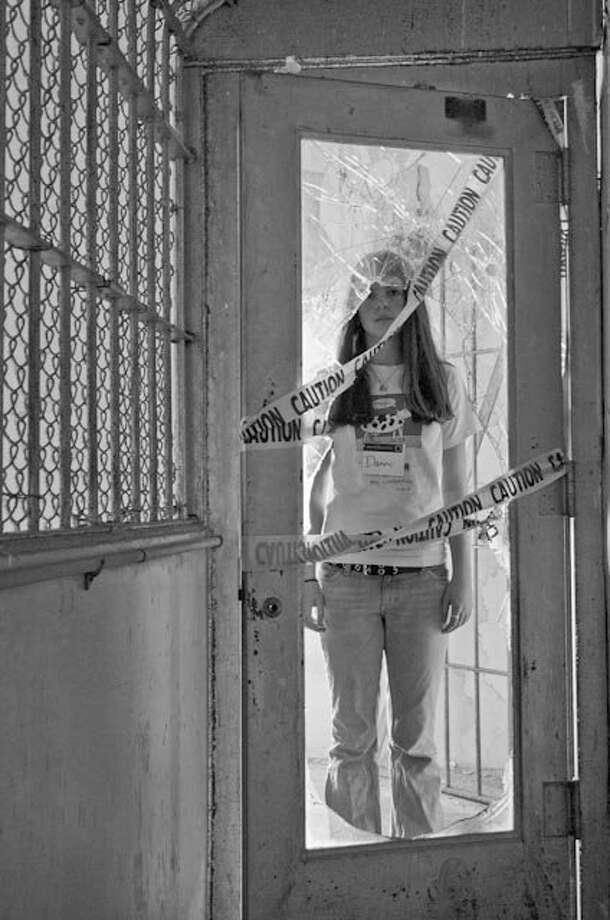 """Photographer Danni Sempere, 13, on Alcatraz Island for the book """"Hidden Alcatraz."""" Photo: Thom Sempere"""