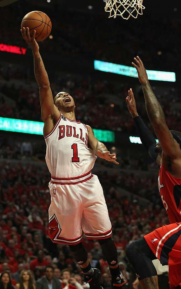 CHICAGO, IL - MAY 10: Derrick Rose #1 of the Chicago Bulls puts up a shot on his way to a game-high 33 points against the Atlanta Hawks in Game Five of the Eastern Conference Semifinals in the 2011 NBA Playoffs at the United Center on May 10, 2011 in Chicago, Illinois. The Bulls defeated the Hawks 95-83. NOTE TO USER: User expressly acknowledges and agrees that, by downloading and/or using this photograph, User is consenting to the terms and conditions of the Getty Images License Agreement. Photo: Jonathan Daniel, Getty Images