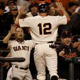 Nate Schierholtz is welcomed back to the dugout in the 8th inning after scoring by Andres Torres. The San Francisco Giants defeated the Texas Rangers 9-0 in game 2 of the 2010 World Series.