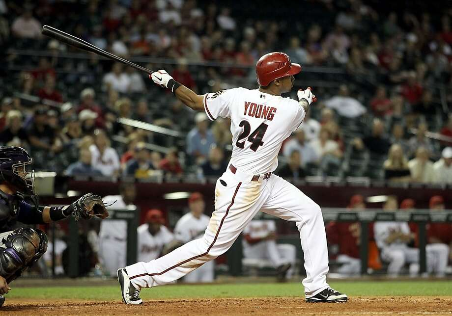 PHOENIX, AZ - MAY 05:  Chris Young #24 of the Arizona Diamondbacks hits a solo home run against  the Colorado Rockies during the ninth inning of the Major League Baseball game at Chase Field on May 5, 2011 in Phoenix, Arizona. Photo: Christian Petersen, Getty Images