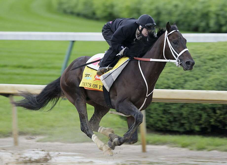 Kentucky Derby hopeful Pants On Fire, ridden by jockey Rosie Napravnik, is exercised on the Churchill Downs track on Sunday, May 1, 2011, in Louisville, Ky. Photo: Ed Reinke, AP