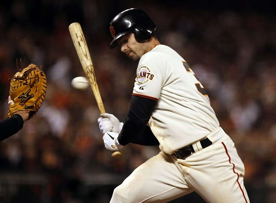 The San Francisco Giants' Aaron Rowand is brushed back in the ninth inning Saturday. Rowand went on to get a base hit, steal second base and score the winning run on Mike Fontenot's sacrifice fly to beat the Colorado Rockies 3-2 in San Francisco. Photo: Lance Iversen, The Chronicle
