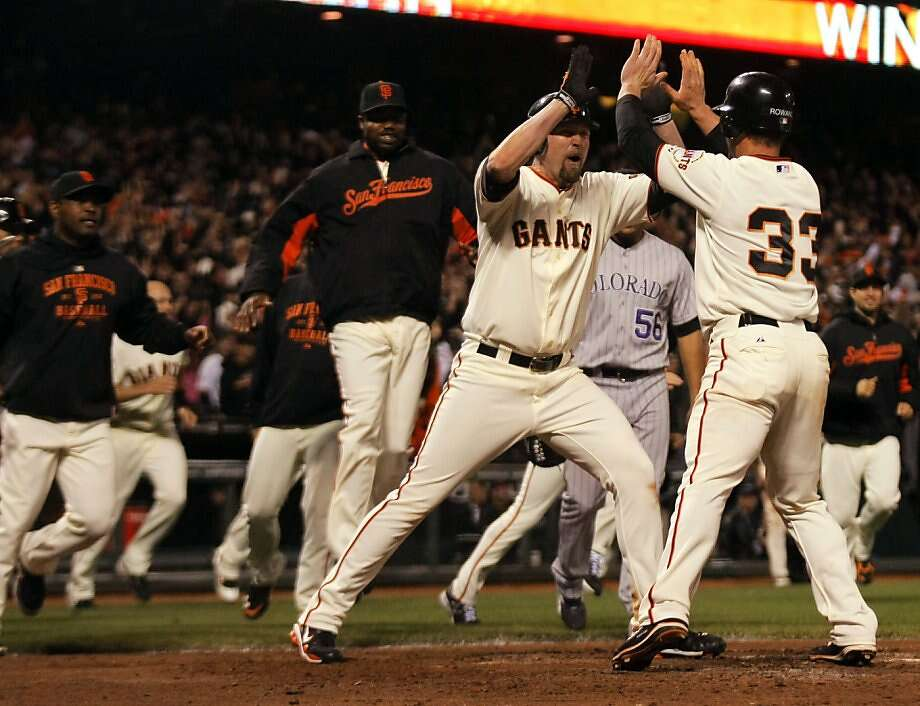 San Francisco Giants Aubrey Huff and Aaron Rowand (33) celebrate after Rowand scored on Mike Fontenot's sacrifice fly in the bottom of the ninth inning to beat the Colorado Rockies 3-2 in San Francisco on Saturday. Photo: Lance Iversen, The Chronicle
