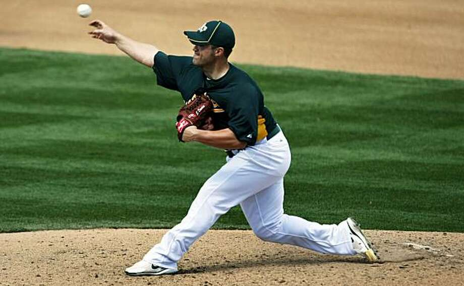 Oakland Athletics pitcher Joey Devine throws to the Seattle Mariners during the fourth inning of their spring training baseball game at Phoenix Municipal Stadium in Phoenix, Ariz. Monday, March 7, 2011. Photo: Lance Iversen, The Chronicle