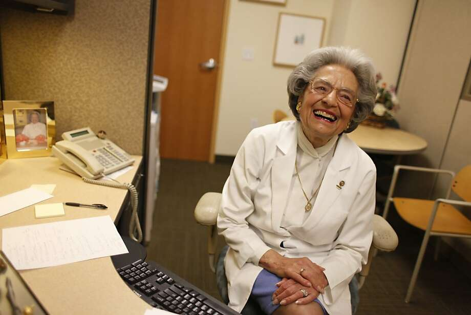 """Elena Griffing, 85, who's worked at Alta Bates Hospital for 65 years and hasn't call in sick since 1949, laughs at having her picture taken in her office  on Thursday April 28, 2011 in Berkeley, Calif.  """"I'm 85-years-old - I feel like I'm 20. Life is great. I can't wait to get up in the morning. Alta Bates is my home away from home,"""" said Griffing. Photo: Mike Kepka, The Chronicle"""