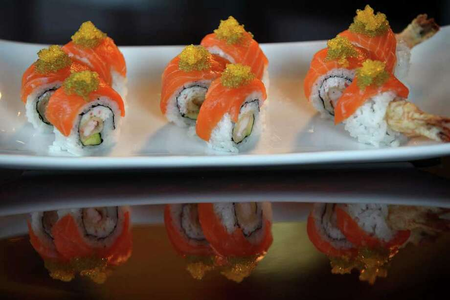TASTE - The nine-piece Sumo Roll comes with mixed snow crab, tempura shrimp, avocado, salmon and tobiko at Sushi Express located on Stone Oak Parkway, Tuesday, Dec. 6, 2011. JERRY LARA/glara@express-news.net Photo: JERRY LARA, San Antonio Express-News / SAN ANTONIO EXPRESS-NEWS