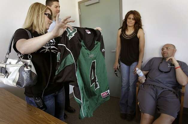 Campus supervisor, Jamie Nascimento, shows off the high school jersey of former qurterback Colin Kaepernick, to fellow staff, (left to right) Phil Sanchez, counselor, Lisa Narciso, campus supervisor and Brandon Harris, football coach, on Wednesday May 4, 2011, at Pitman High School where the San Francisco 49ers second round draft pick, Colin Kaepernick  went to high school in Turlock, Ca. Photo: Michael Macor, The Chronicle