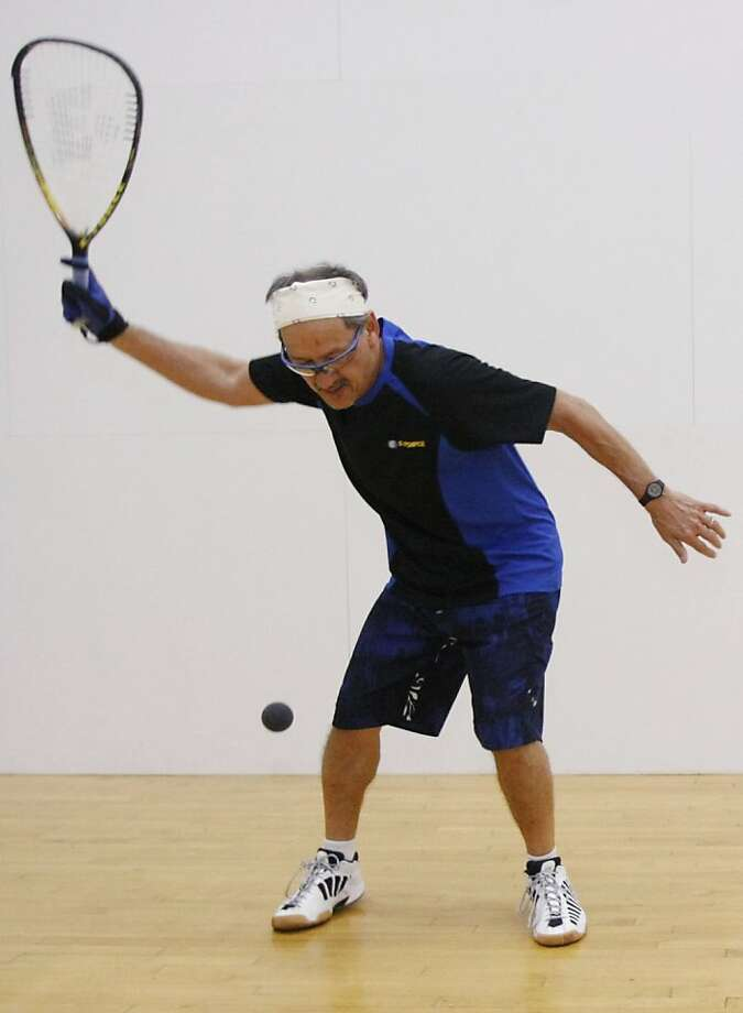 Belo Elison, 59, warms up on a racquetball court at the Mariner Square Athletic Club in Alameda Calif. on Tuesday, Jan. 25, 2011. Elison met both his wife and best man through his healthy obsession and has been playing racquetball for about twenty years. Photo: Alex Washburn, The Chronicle