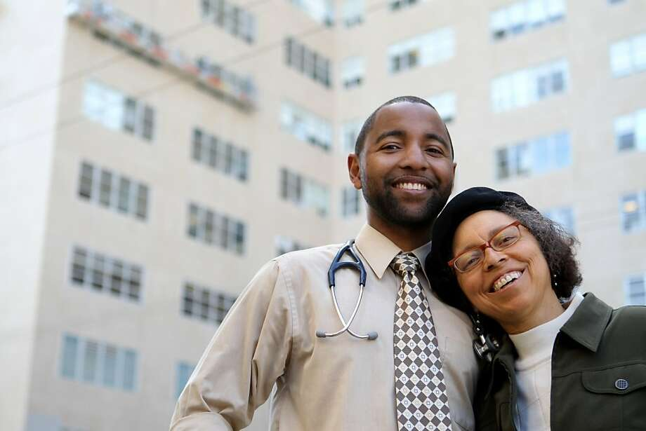 Willie Moses, left, and his mother, Alma Robinson, stand outside the UCSF Hospital in San Francisco, CA Thursday, May 5, 201, where Moses is about to graduated from medical school. Robinson also attends classes at UCSF in the Mini Medical School for the public, a series of programs about health and health sciences taught by UCSF experts.  Moses also attended classes at the MiniMedical School while in high school. Photo: Erin Lubin, Special To The Chronicle