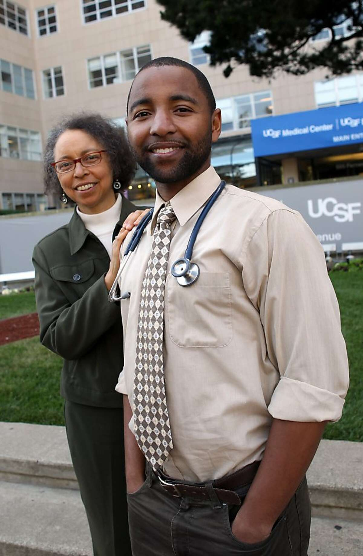 Alma Robinson, left, and her son, Willie Moses, right, stand outside the UCSF Hospital in San Francisco, CA Thursday, May 5, 201, where Moses is about to graduated from medical school. Robinson also attends classes at UCSF in the Mini Medical School for the public, a series of programs about health and health sciences taught by UCSF experts. Moses also attended classes at the MiniMedical School while in high school.