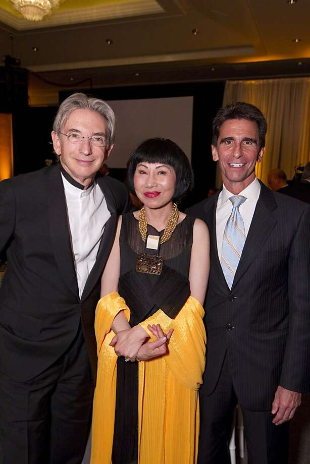 Honoree Michael Tilson Thomas with Amy Tan and Sen. Mark Leno at the San Francisco Gala benefiting amfAR on Nov. 11 at the Four Seasons Hotel in San Francisco. Nearly $350,000 was raised for AIDS research. Photo: Drew Altizer, Drew Altizer Photography