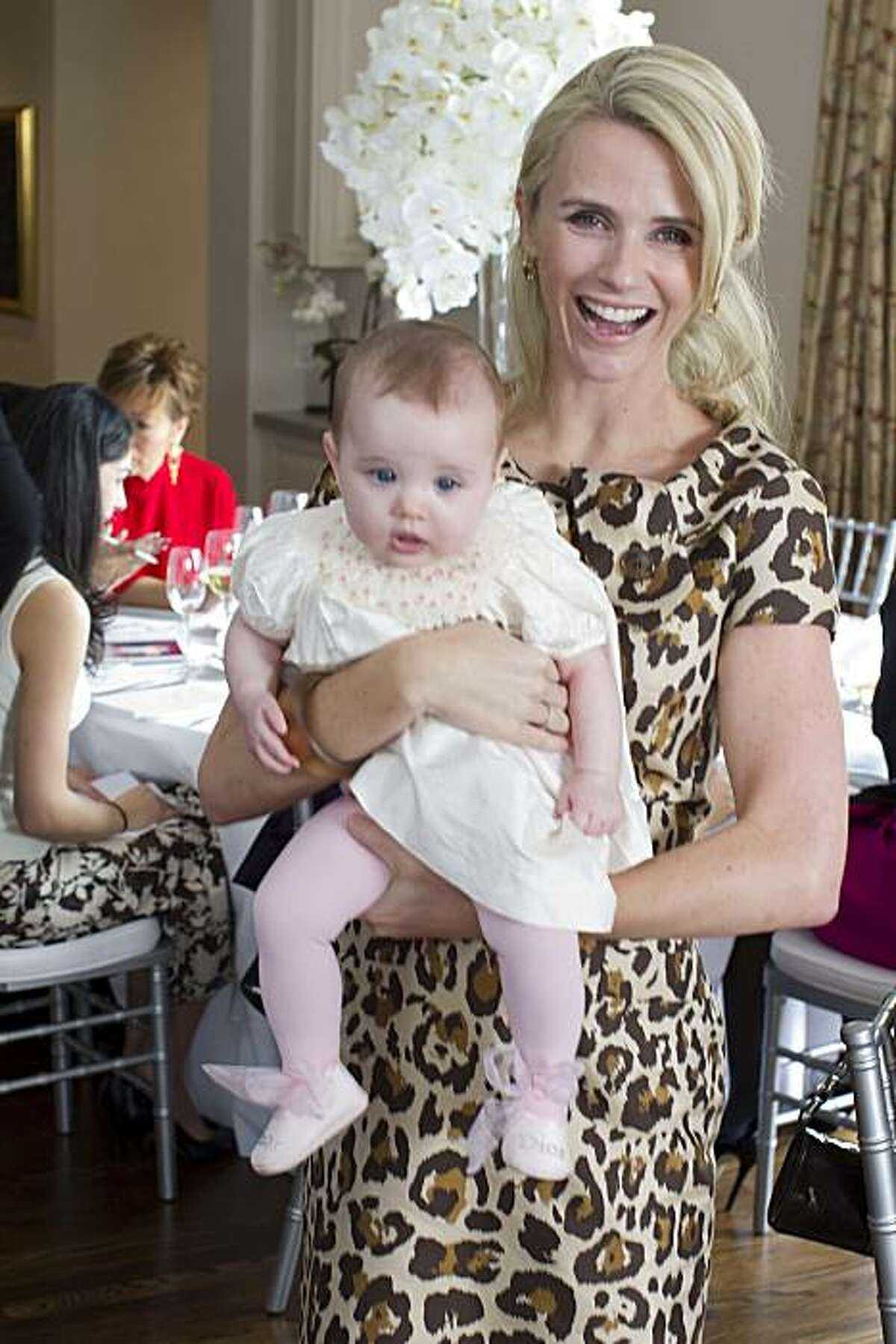 Select pieces from the archives of Christian Dior in Paris were shipped and put on display at the home of Pamela Joyner at a luncheon to introduce stylish San Francisco women to Dior's history, and its spring 2010 collection of clothing. Here, Jennifer Siebel Newsom, and her baby daughter, Montana, steal the attention away from models parading in Dior's summer 2010 collection. Jennifer Siebel Newsom, Montana Newsom