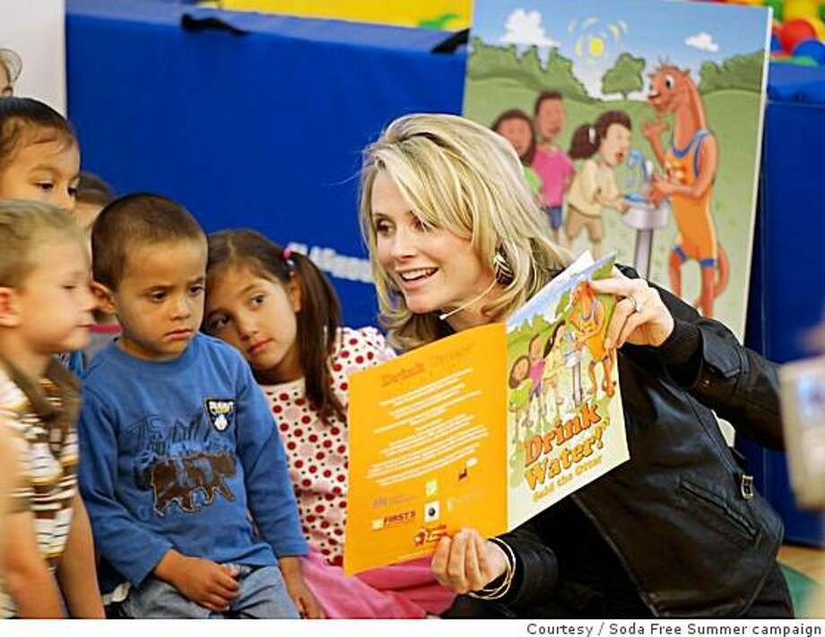 San Francisco First Lady Jennifer Siebel Newsom reads to children at Holy Family Day Home Preschool at the launch of First 5 San Francisco's Soda Free Summer campaign Photo: Courtesy, Soda Free Summer Campaign
