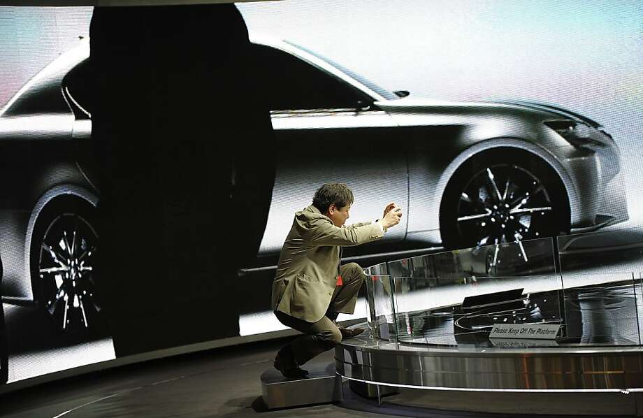 A journalist takes photos of the Lexus-LF-Gh hybrid during the 2011 New York International Auto Show at the Jacob Javits Convention Center in New York April 21,2011. Photo: Timothy A. Clary, AFP/Getty Images