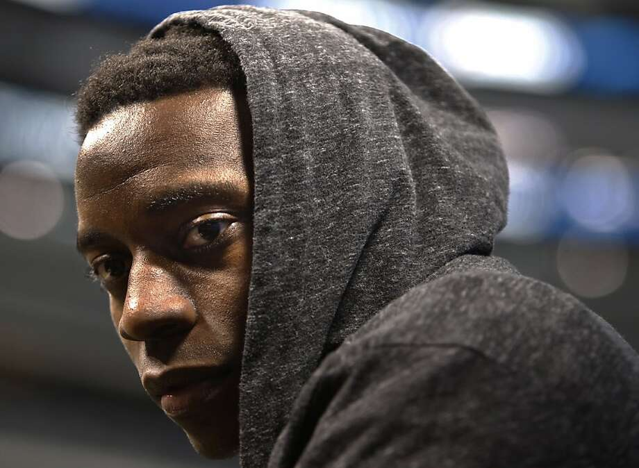 FILE - This Feb. 1, 2011, file photo shows Pittsburgh Steelers'  Rashard Mendenhall wearing a sweatshirt as he answers questions during media day for Super Bowl XLV, in Arlington, Texas. Mendenhall has created a stir with comments made on his official Twitter page regarding Osama bin Laden's death. Photo: Mark Humphrey, Associated Press