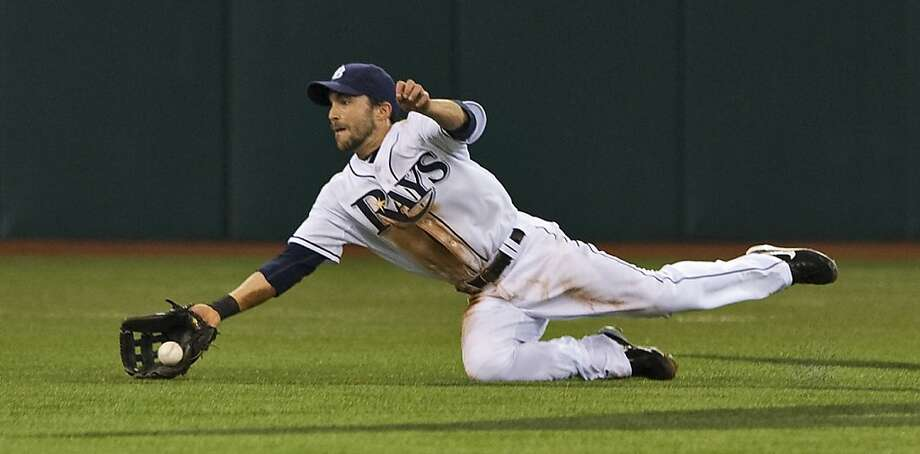 Tampa Bay Rays center fielder Sam Fuld makes a diving catch on a fly ball hit by Chicago White Sox's Brent Morel during the third inning of a baseball game Monday, April 18, 2011, in St. Petersburg, Fla. Photo: Steve Nesius, AP