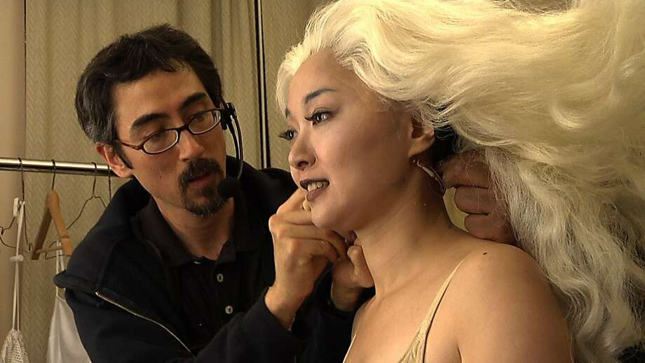 "Opera singer Qian Yi gets outfitted to play the ghost in a scene from the documentary, ""Journey Of The Bonesetter's Daughter."" Photo: Monica Lam, Outlier Films, LLC/2008"